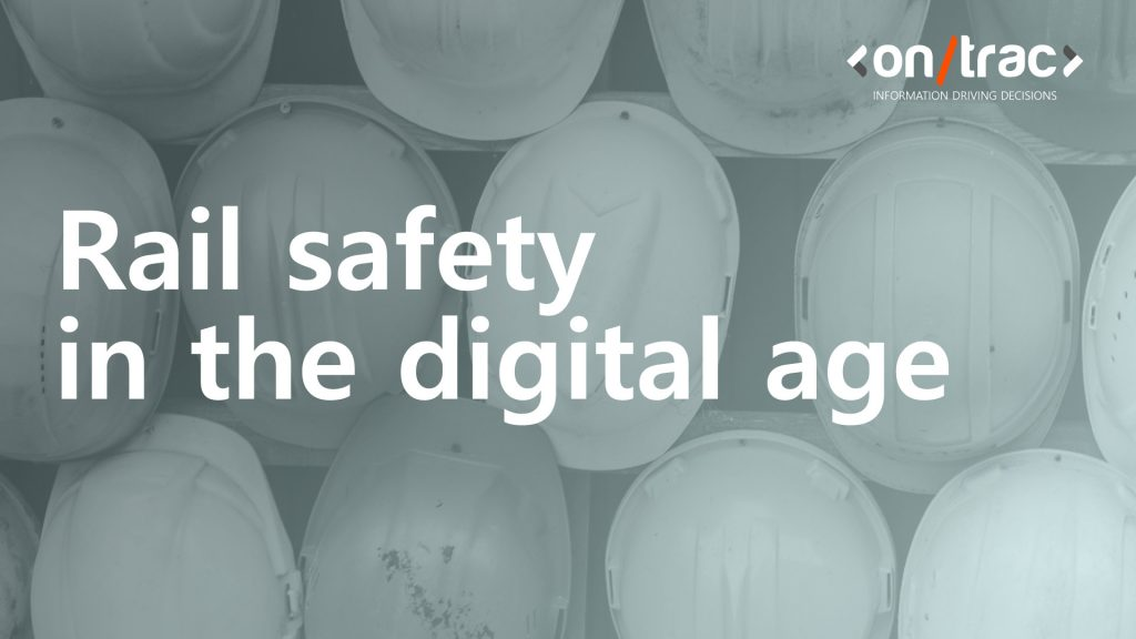 Rail worker hard hats hanging on a wall, with a blue layer over the front, with the words 'rail safety in the digital age' at the front of the image.