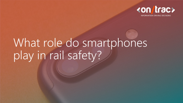 Closeup of a smartphone camera with overlayed text saying 'What role do smartphones play in rail safety?'